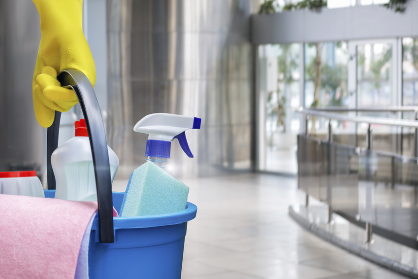 Cleaning lady with a bucket and cleaning products